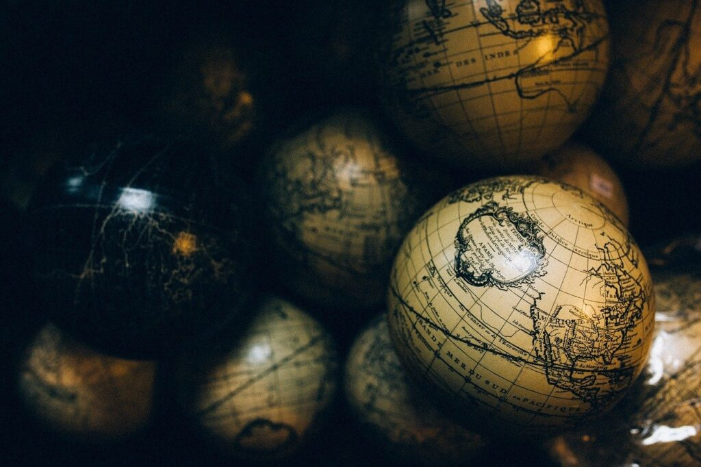 World globes in various sizes and one in black